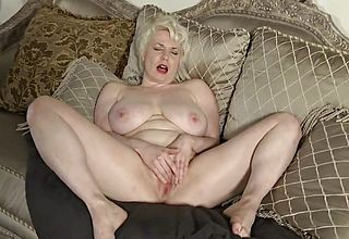 Huge boobed mummy fingering on the sofa