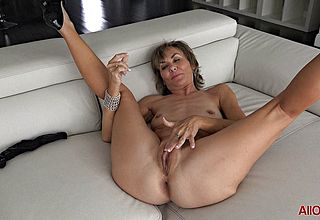 Senior Mature L playthings herself on couch